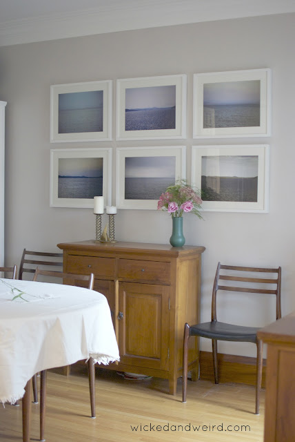 dining room photo wall white frames