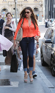 Sofia Vergara hot in tight jeans and an orange top