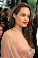 Beautiful Angelina Jolie in elegant dress with make-up
