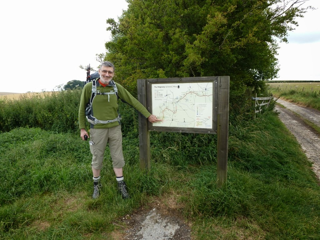 Alan by information sign and map