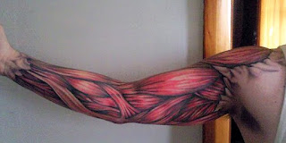 3d tattoo creating the illusion that the skin is ripped and the arm's muscles are visible