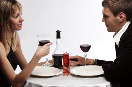 What To Say On A First Date - man and woman drink wine - dinner