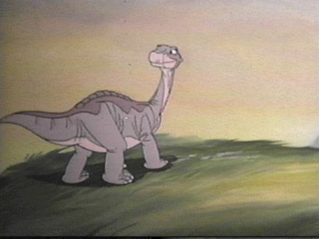 dinosaur looking back over its shoulder in The Land Before Time 1988 animatedfilmreviews.filminspector.com
