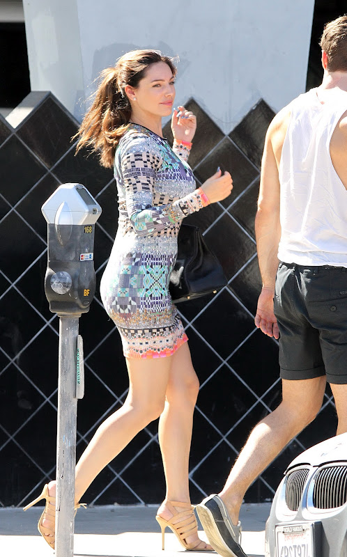 Kelly Brook wearing mini dress as she goes for a walk with fiance Thom Evans in LA