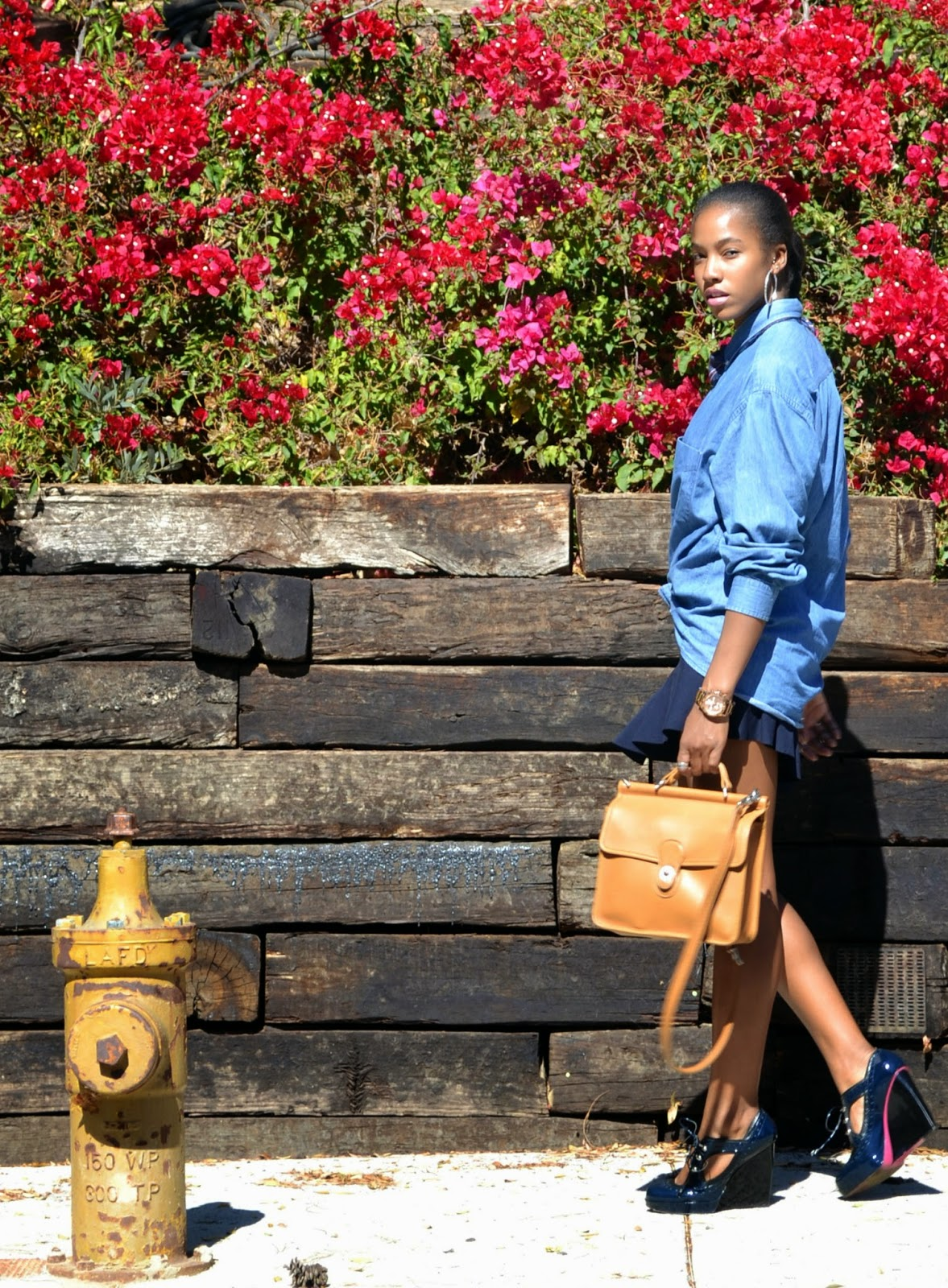 how to wear an oversized button down with a mini skirt