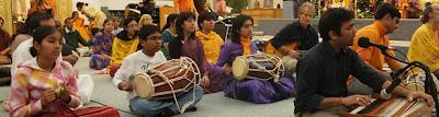 Devotees chanting kirtans composed by  Jagadguru Shree Kripalu Ji Maharaj
