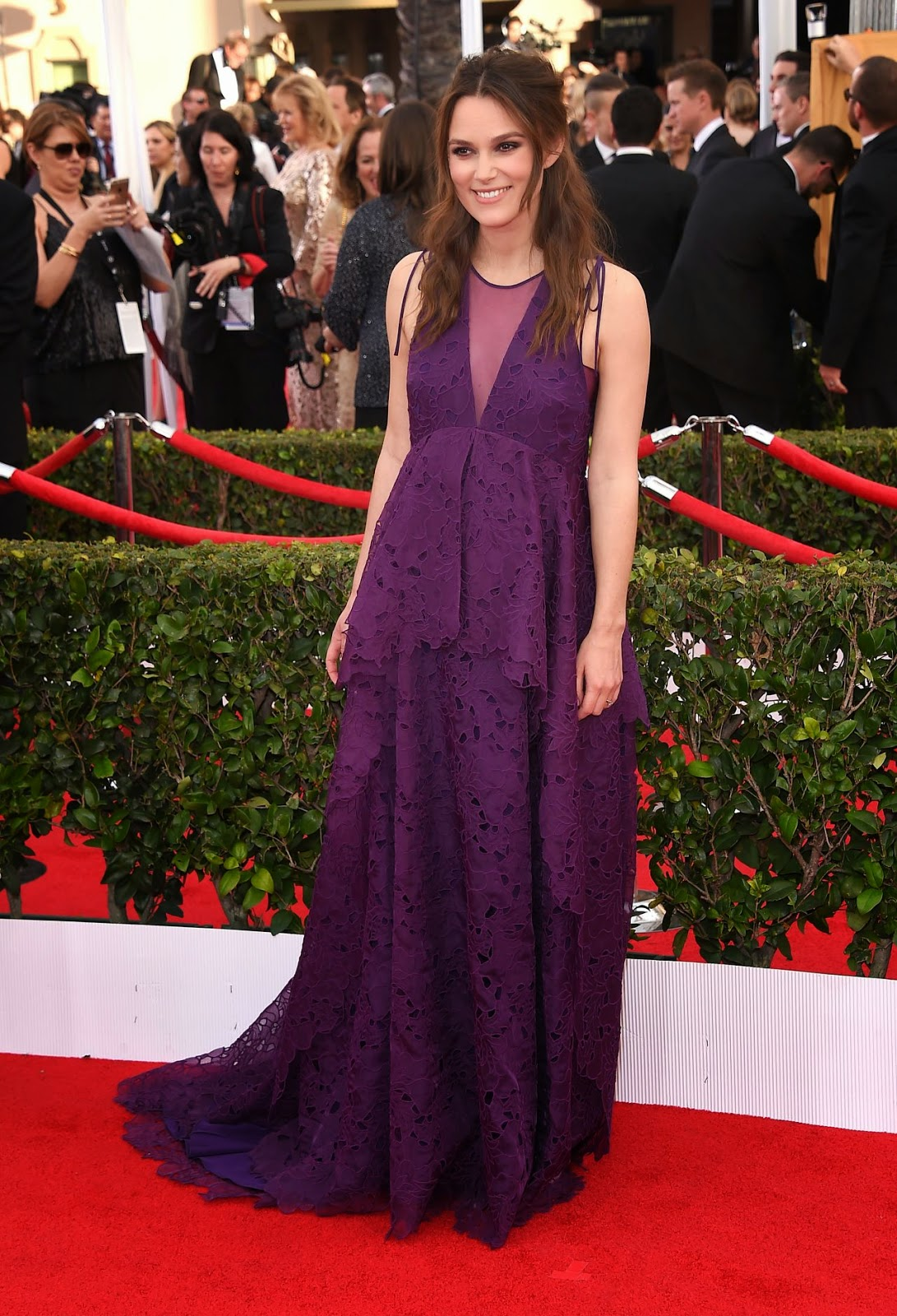 Keira Knightley wears a purple Erdem dress at the 21st Annual SAG Awards in LA