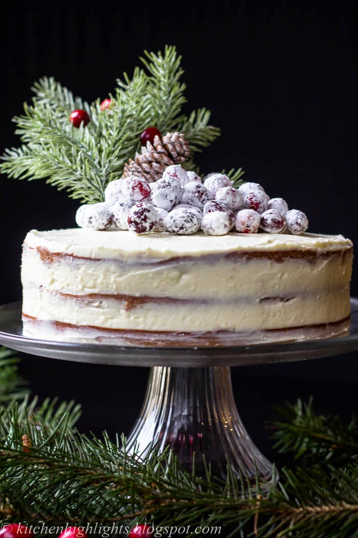 Three layers of soft gingerbread are stacked with a thick cream cheese frosting