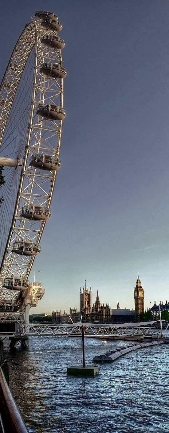 The London Eye and the Houses of Parliament in a beautiful summer afternoon -- London, England.