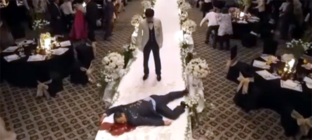 Hae Young stands in front of a bloodied corpse as guests flee the wedding hall