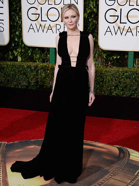 Kirsten Dunst stuns in a strappy LBD at the Golden Globes 2016