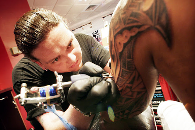 the process of making a tribal tattoo
