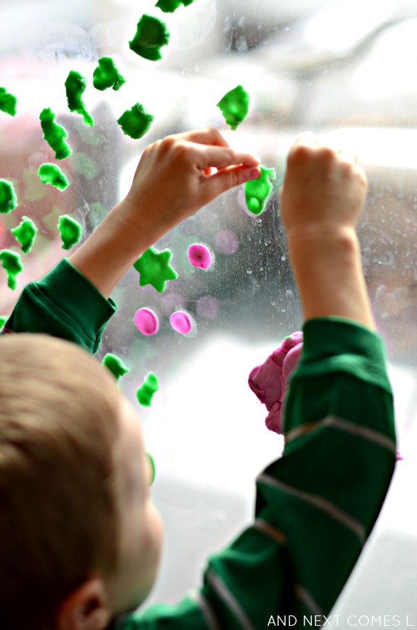 Fine motor window art for kids using play dough from and Next Comes L