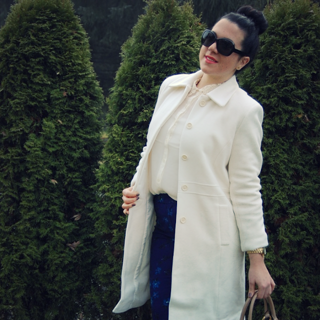 Winter white wool coat with Gap floral pants and a Marc Jacobs handbag