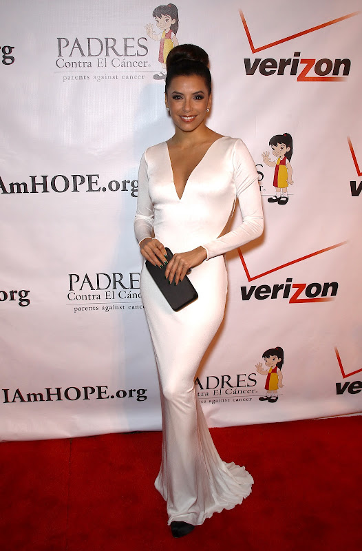 Eva Longoria wearing a glamorous white dress