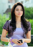 Tamanna Hot Exposing Photostills From 100% Love