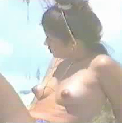 Puffy nipples babe on the beach