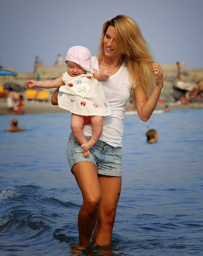Remember that moment Michelle Hunziker shut up all the haters about her weight loss progress and post baby body. That is one sexy as the 37-year-old was snapped to enjoyed her recent holiday with the daughter at the beach in Varigotti, Italy on Thursday, June 12, 2014.