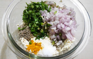 Add Onion Cumin Seeds Carom Seeds Green Chili Coriander Leaves Turmeric Powder Oil And Salt