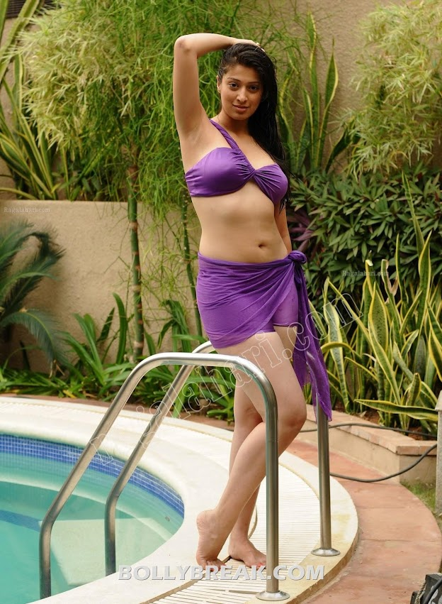 Lakshmi rai posing in purple bikini showing off her navel and hot legs -  Lakshmi Rai in Bikini pics