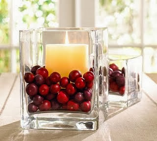 candle centerpiece with cranberries
