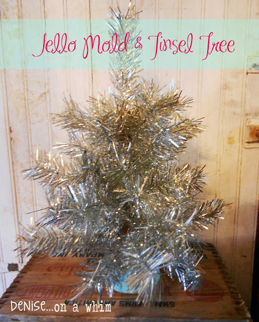 A Christmas tree from a chair dowel, a jello mold and some shiny silver tinsel via Denise On a Whim