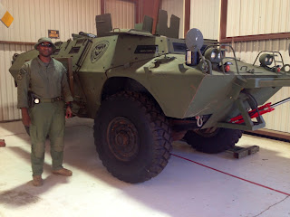 Thomas stands next to a armored vehicle used by the SRT.