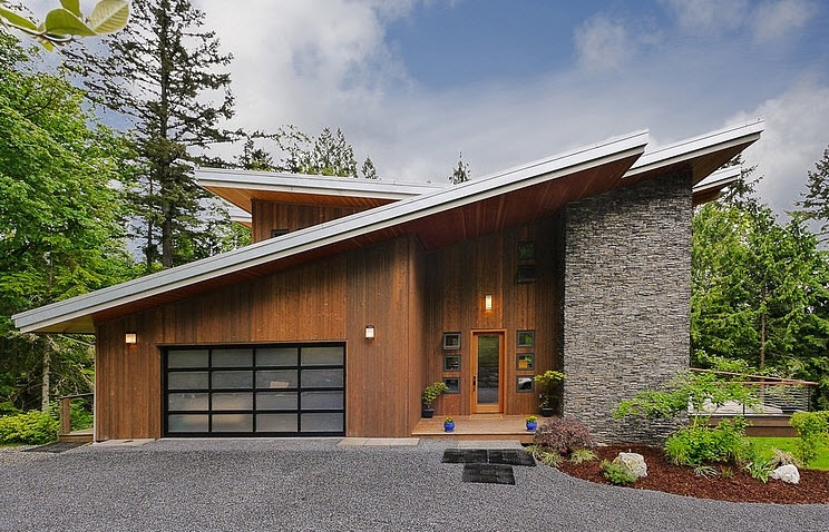 Dise o de casa moderna en la monta a rodeada de vegetaci n for Casa en la montana