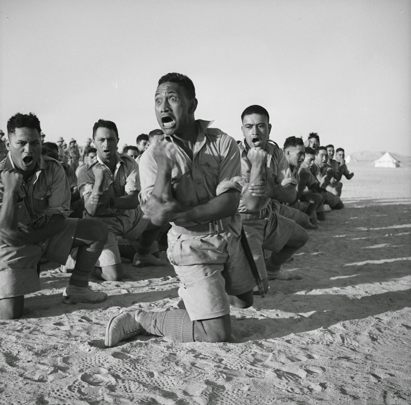 Members of the Maori Battalion who had fought in Greece perform a Haka for the King of Greece at Helwan, Egypt in June 1941.