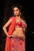 Bollywood and Tollywood acress Mallika, Sherawat,curves in bridal dress,