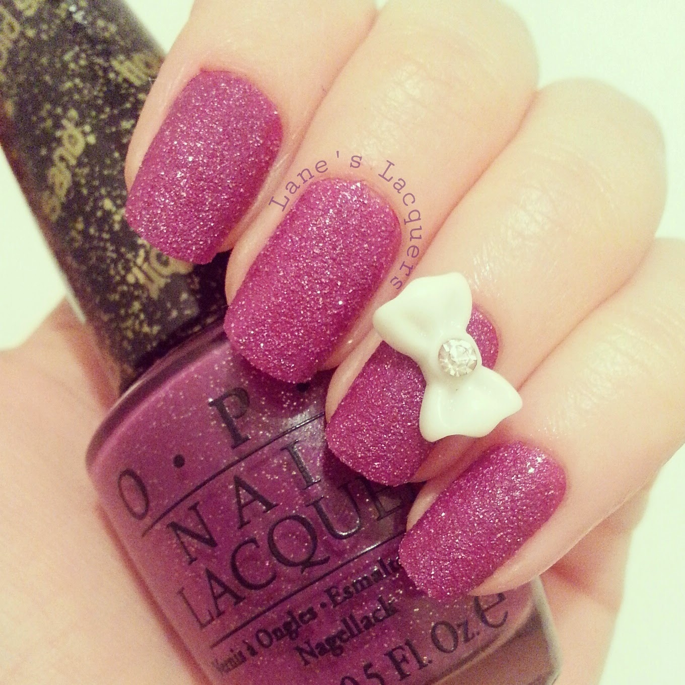 OPI-liquid-sand-my-secret-crush-3d-bow-manicure (2)