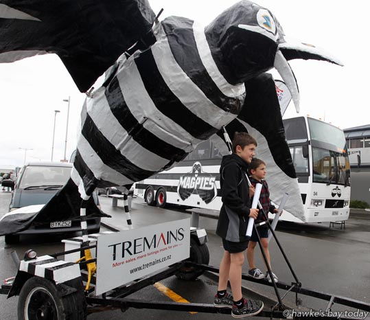 L-R: Lochlan Stent, 10, George Stent, 6, Hastings, posing with Hawkeye - Hawke's Bay Magpies rugby team, returning to Hawke's Bay Airport, Napier, with the Ranfurly Shield, after beating Otago 20-19 in Dunedin on Sunday. photograph