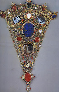 The stomacher from the Devonshire parure: enameled gold set with engraved gems from the collection of the Dukes of Devonshire and glass pastes in place of the original diamonds. Trustees of the Chatsworth Settlement