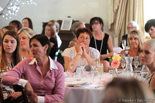 Some of the diners listening to Nicola Greville, Hastings, the guest speaker, talking about her experience with her son Marcus, at a Business Belles charity auction and lunch for Child Cancer Foundation, at Ormlie, Taradale, Napier. photograph