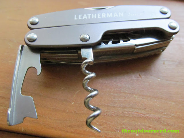 Leatherman Juice Xe6 multi-tool showing closeup of corkscrew and bottle/can opener