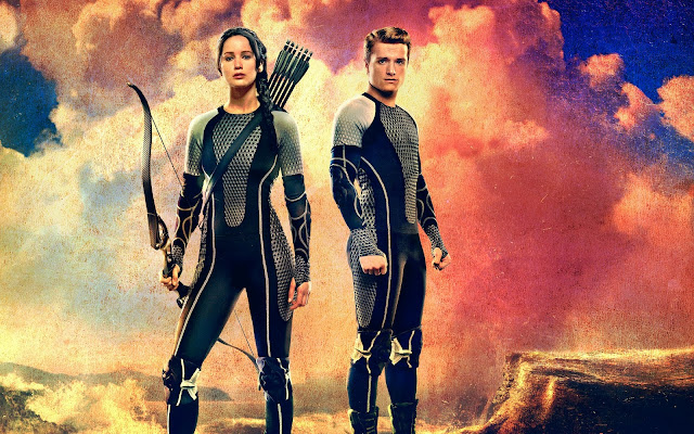 http://www.hdwallpapers.in/katniss_peeta_the_hunger_games_catching_fire-wallpapers.html