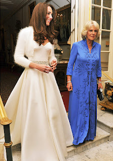 After the wedding, Kate Middleton steps out into the evening wearing this hot number, accompanied by Camilla Parker-Bowles as they head to Buckingham Palace