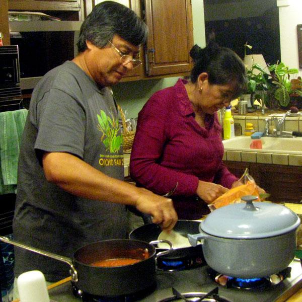 Sergio and Emilia Salazar make entomatadas in our kitchen