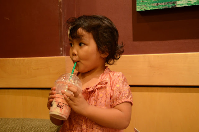 Kecil sipping coffee
