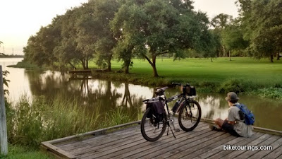 Picture of mountain bike and rider sitting on fishing pier