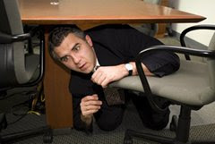 Man hides under desk