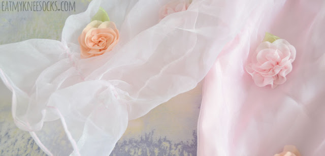 Close-up of the sheer ruffle-hem sleeves from Romwe's pastel pink boat-neck gyaru dress.
