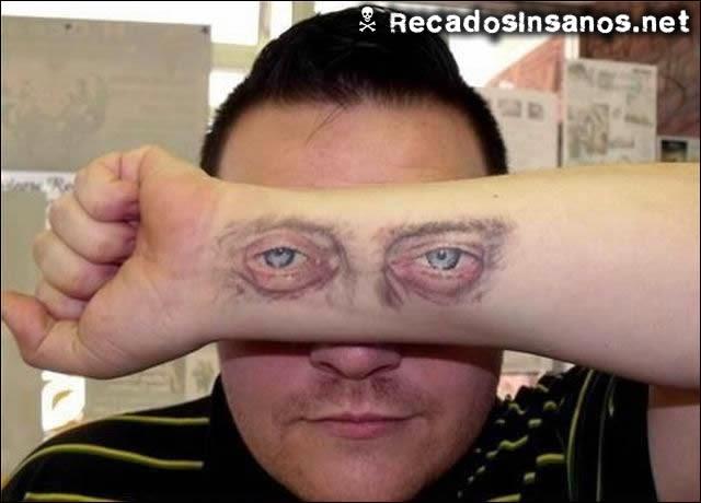 tatuagem olhos no braço
