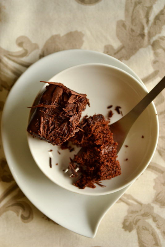 vegan chocolate cake on a plate with fork