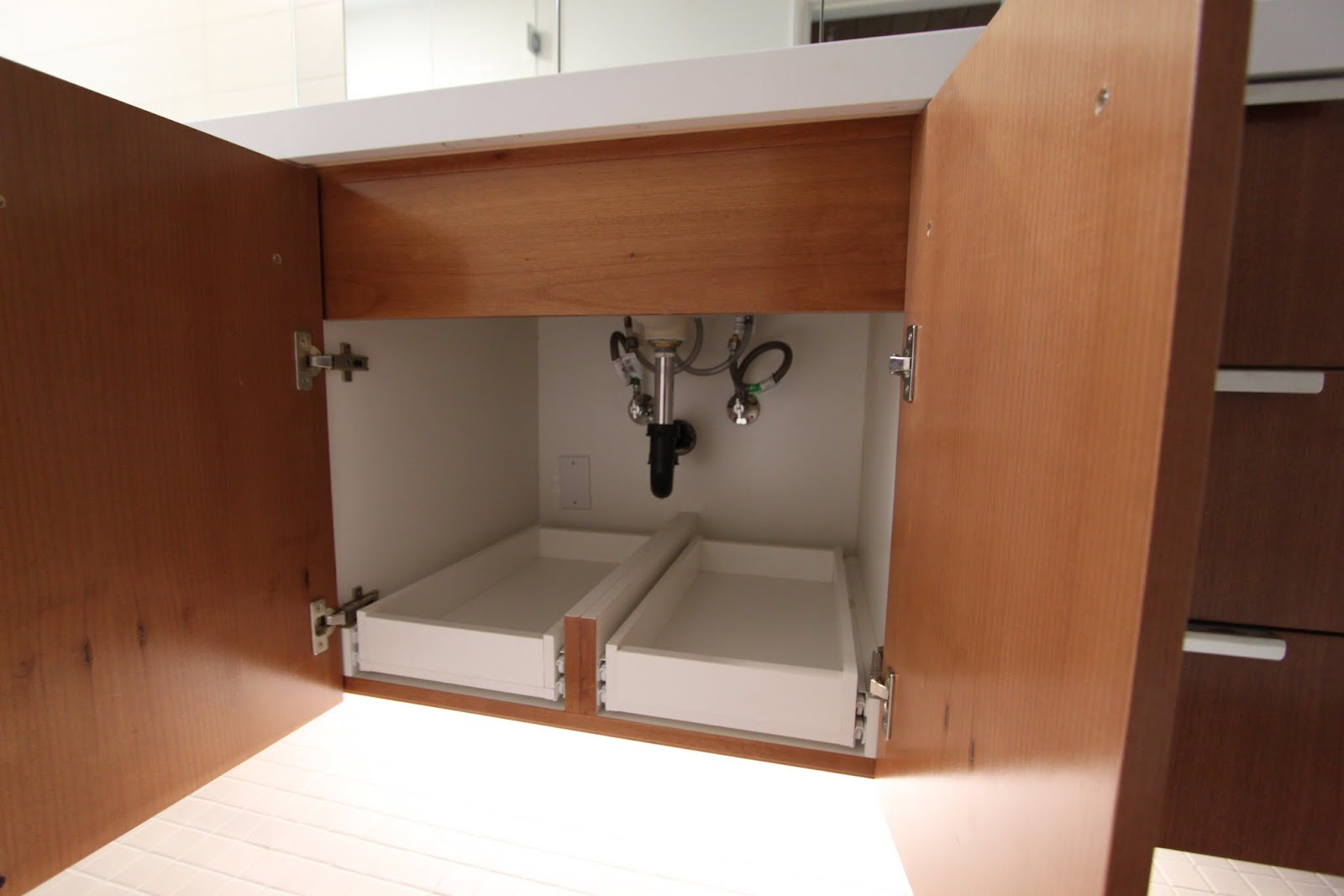 Under cabinet bathroom storage