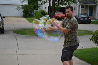Dad attempting to make a giant bubble