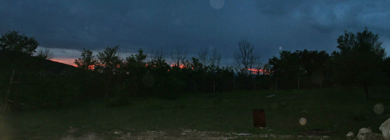Blazing orange sunset with dark clouds