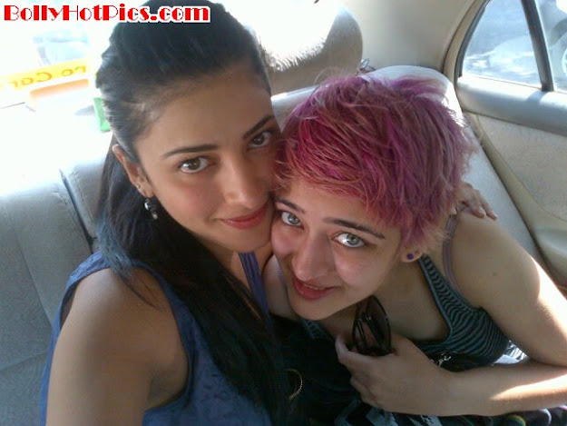 Shruti hassan posing with people from her life  -  Shruti Hassan Personal Twitter Photos