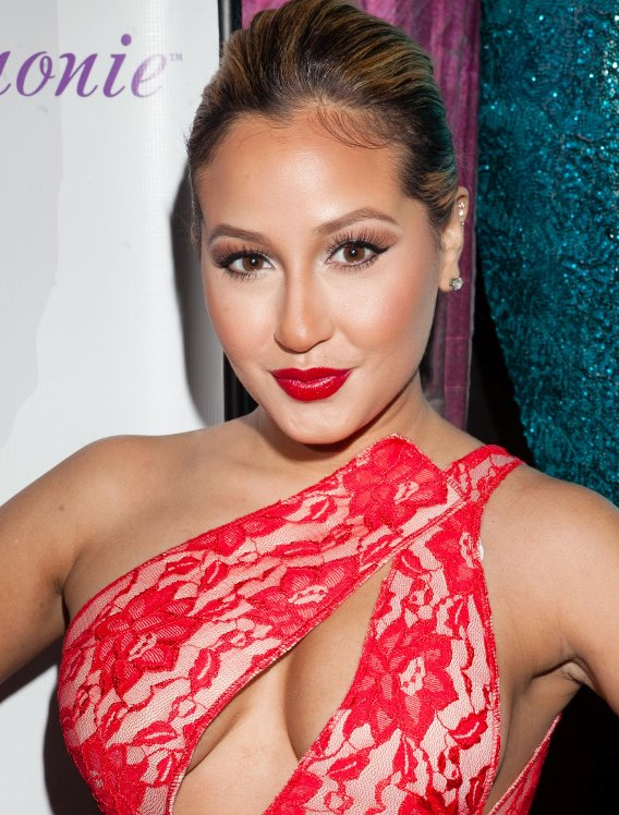 Adrienne Bailon Wardrobe MalFunction in Cut-Out Dress