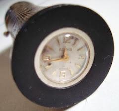 Korek Alpha Swiss dengan Jam Mekanis